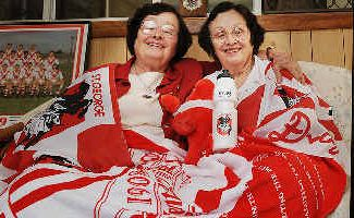 Fanatics: South Lismore residents Emily (left) and Mary Betteridge surrounded by their St George memorabilia in anticipation of Sunday's game.