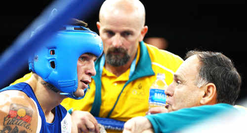 Damien Hooper listens to advice from his corner during a bout against Juan Carlos Carrillo of Colombia.