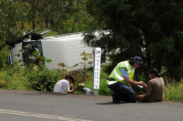 A woman has died in a mini-bus rollover at Gatton, west of Brisbane.