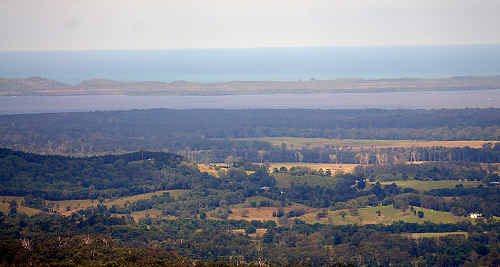 NEXT DOOR: The view from Wolvi Mountain over Wolvi, Lake Cootharabar and the ocean.