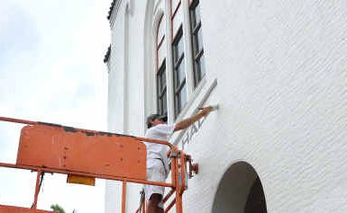 Justin Alderton of Grant's Painters gives the Holy Trinity church a new coat of paint.