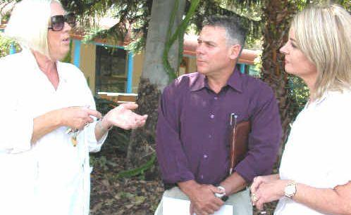 Maggie Behal speaks with Member for Burnett Rob Messenger and Cal-Med Family Practice owner Debbie Calcagnini.