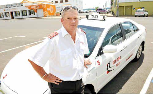 Taxi driver John See and his hybrid car.