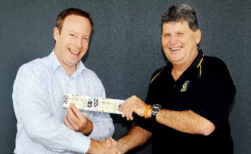 Neil Worth (right) receives his Grand Final tickets from the Chronicle's general manager, Jon Steel.