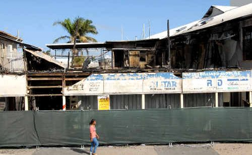 Debris from the burnt-out Hossacks store at River Street, on the bank of the Pioneer River, could become airborne during a storm.