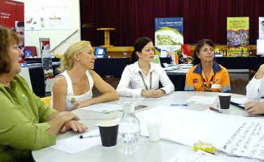 Jane Bobbermein of Gradman's Place, Danielle Law of Pacific Parks Estate, Ebony Ey and Suzanne McLauchlan of QR National, Mackay Regional Council's Development Services director Peter Cardiff and Community Projects Officer Jodie Pietzner gather at the Sarina Business on Show forum.