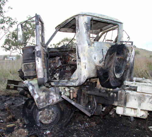 A burnt-out vehicle from a crash involving an Army truck and a B double on Wednesday.