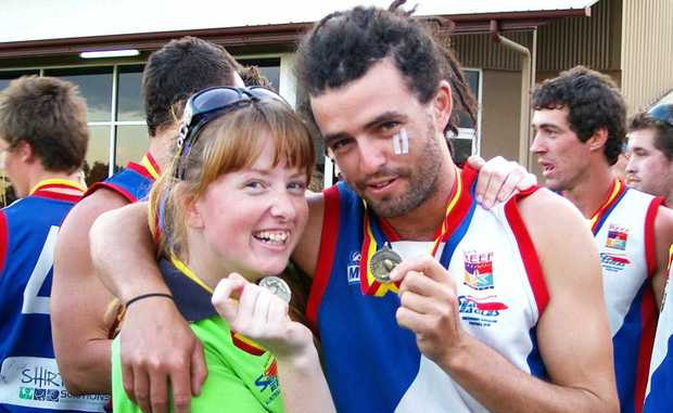 Stacey Lynch is looking forward to being a trainer in the VFL (Victorian Football League) in 2011. She is seen here with Whitsunday Sea Eagles player Trent Bradley following the Sea Eagles grand final win earlier this month.