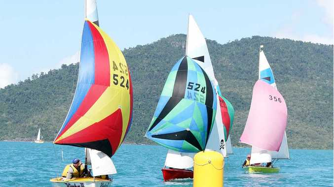 Kimbo II leads fellow Whitsunday boats Thong and Well Lay'd around the mark on day two of the Corsair National Championships on Monday.