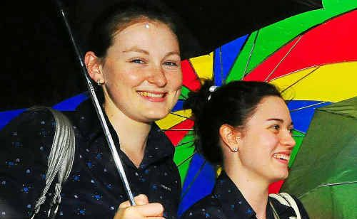 Kate Arkell and Sarsha Pincini dash for cover from the rain.