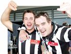 Sunshine Coast fans James Page and Dean Upton celebrate the Magpies' premiership win in 2010.