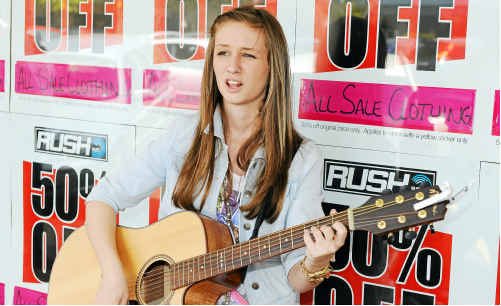 Kelsie O'Leary wows shoppers in the CBD on Saturday with her voice as part of Crush Festival's Bundy Busk. bus0210b