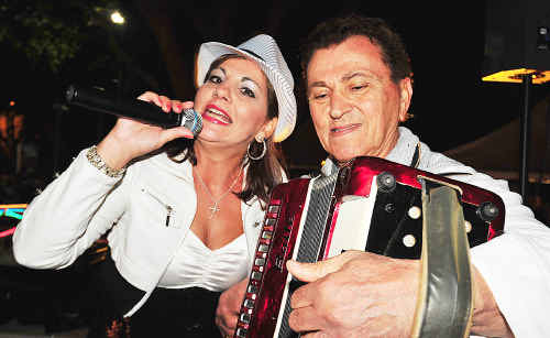 Vocalist Zena Neophytou and piano accordion player David David entertaining the crowd.