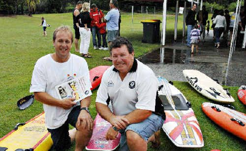 Brunswick Heads Surf Life Saving Club president Craig Reid (left) and club historian Ray Linabury celebrate the outfit's 75th Anniversary on Sunday. The milestone was marked with the publication of a book about the club's esteemed history.