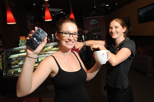 Gina Campbell (left) from Emjay's was an hour early for work after a mix up with the alarm on her phone. Cafe manager Mary Griggs reminds Gina of the correct time.