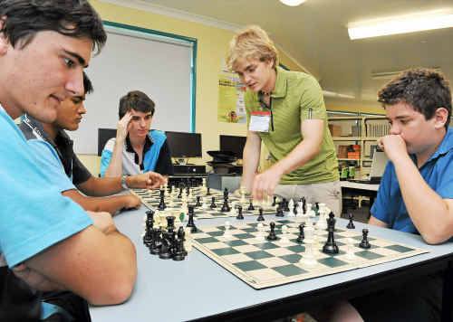 David Nelson, Anish Preshy, Wesley Stone and Jason Ruhle receive tips from Czech Republic chess master Honza Priborsky.
