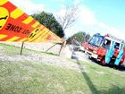 Stand back: Tweed Heads and Kingscliff firefighters clear off eroded Kingscliff Beach.