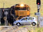 Cops search for car that raced train through crossing