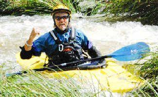 Thrill-seeker: Kayaker Guy Baker, of Mullumbimby, yesterday took advantage of the swollen Wilsons Creek after heavy rain on Monday.