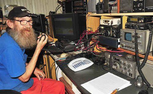 Ray Stockdale mans the amateur radio at Ferry Lane, Maryborough.