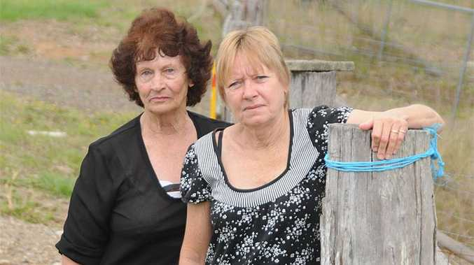 Shirley Summerville and Sussan Corley warn dogs need to be fenced off.