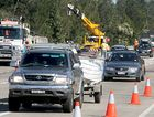 Traffic pains: Cars slow to a crawl on the Pacific Highway at Banora Point as one lane is closed for roadworks.