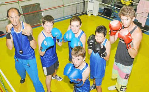 Russell Thompson of Island Sands Boxing Club, Boyne Island and his group of young fighters are off to Warwick on Friday. The team is from left, Coach Russell Thompson, twelve-year old Zachery Challis, fourteen year-old Kadeesha Challis, ten year-old Kallan Peebles, twenty year- old Zac O'Connor and, at front, nine year-old Harry Connell.