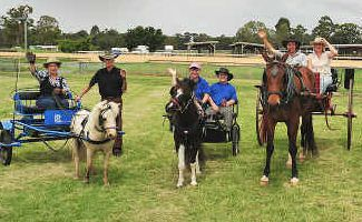 Sulkies at showgrounds: Sue Slavel and John McCarther with Mr Ed, Kathy Hodges and Stephen Standen with Coco Pops, Peter and Annette Cordie with Rick, Mary-Anne Geisler with Gypsy and Ted Anton and Beth Eldred with Chestnut.