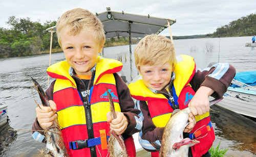 Scott and Jake Sams hold 2.5kg of catfish between them which they caught at the Monduran Family Fishing Classic.