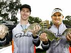 Dan Curry, of Ballina, and Joe Allan, of the Gold Coast, hold up their catch of bream.