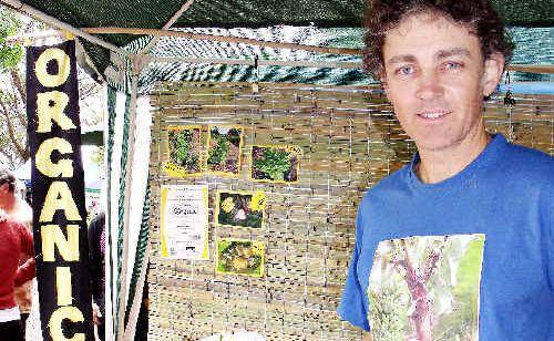 Silas Long from Blessed Bananas at his organic food stall at the Mullumbimby Farmers' Market.