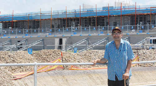 Greg Sutherland stands in front of the new sports stadium which is just 'a roof and seats away' from completion.