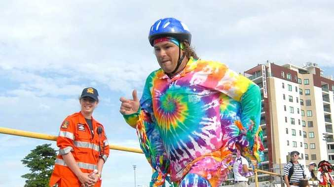 Tie Die Man Matthew hitchens takes off for the Pelican Push at the river to Reef Festival.