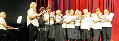 The U3A Chorus, led by Nina Higgins, sings at the Moncrieff Theatre.