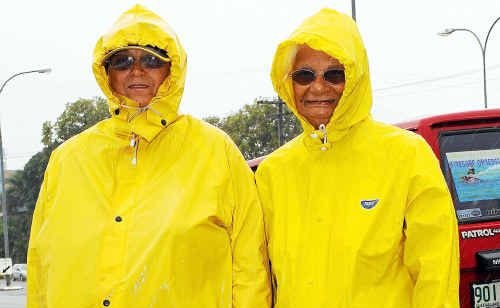 Judith and Myrtle Singho were well prepared for an outing in yesterday's bad weather.