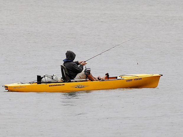 DEDICATED: An angler puts in some hard yakka in the rain for the 2010 North Coast Fishing Bonanza at Ballina.