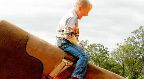 Young Biggenden rider Dustin Fawckner warmed up on the mechanical bull before riding in the team penning at Dallarnil.