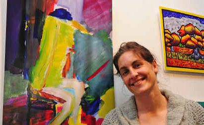 Lisa Stokes with her painting Woman Sitting, one of the works on show this week at the CHESS art exhibition.