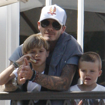 David Beckham with his children. Show your love this Father's Day by sending a photo with your dad.