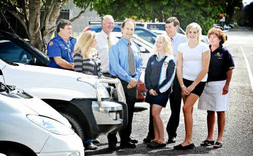 NRMA country business manager Mario Napoli, front centre, presents a $5000 grant to help organisers run a youth driver education program in Grafton schools next year.