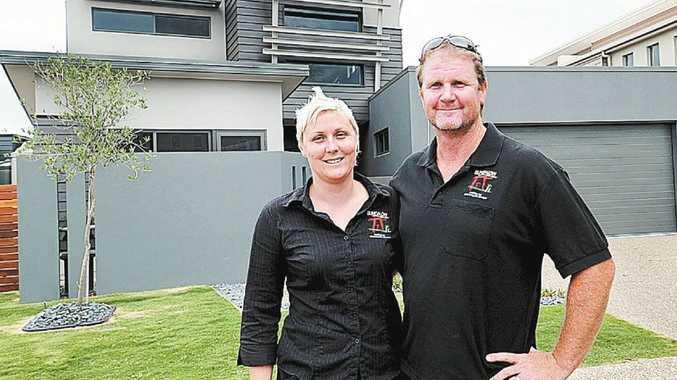 Ross and Angela Scott stand outside their custom designed, HIA award-winning home.
