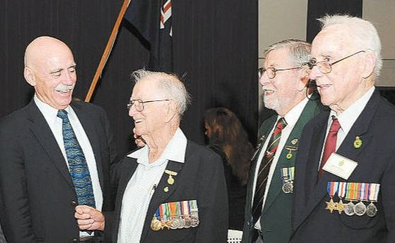 June Harper, Ron Lawrence, Minister Warren Snowdon, Allan Devereau, Don Young and Brian Fennell talk about the needs of war veterans and war widows at the Hervey Bay RSL.