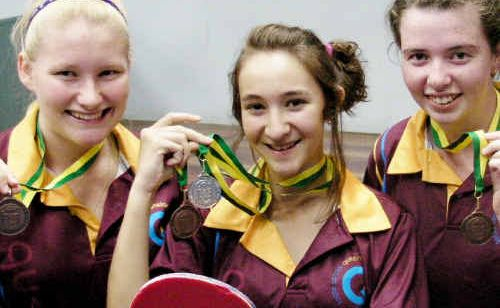 Bundaberg players (from left) Tabitha Loveday, Courtney Rose and Susan McDonald show off their medals from the Australian Junior Table Tennis Championships.