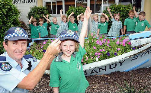 Sandy Strait State School Prep T student Chloe Sengstock, 5, and her classmates with their favourite Adopt-a-Cop Constable Craig Lewis.