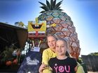 Tia, 9, and her sister Daisy, 7, meet Sponge Bob while visiting the Big Pineapple.