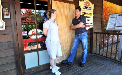 Cathy Parker and Jarrod Medway inspect the busted door at SSS BBQ Barns.