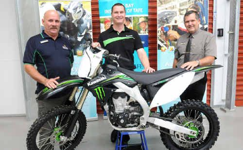 Gympie Tafe engineering teacher Bob Partridge, Kawasaki state sales manager Martin Kypr ,and campus manager Corrie McColl with the $12,000 KX 450 Kawasaki donated to the Tafe.