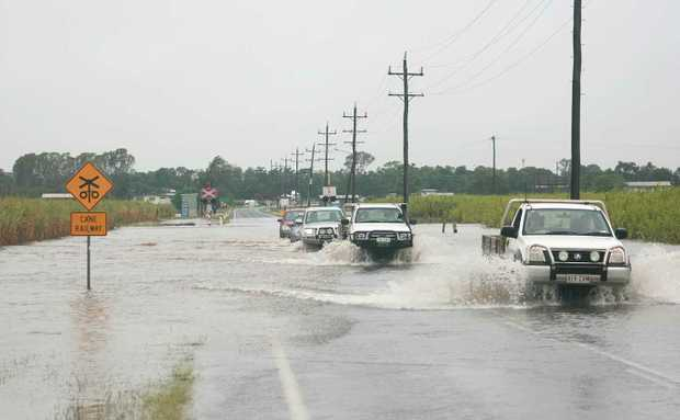 Vehicles making their way across the flooded Hamilton Plains on Monday September 20.