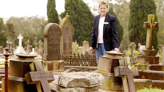 Ros Scotney inspects damage to the Drayton and Toowoomba Cemetery.