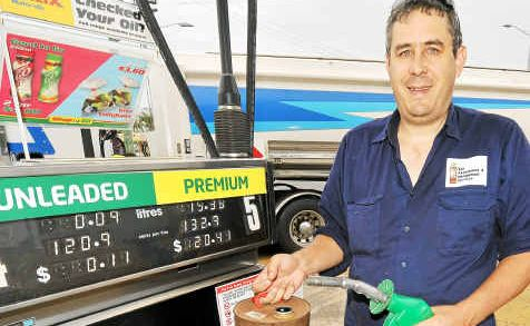 Steve Griffiths fills up his petrol can at the Matilda service station in Walker Street.